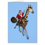 Papá Noel que monta una jirafa Tarjetas