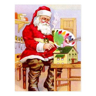 Papá Noel que pinta una casa de muñecas Tarjetas Postales