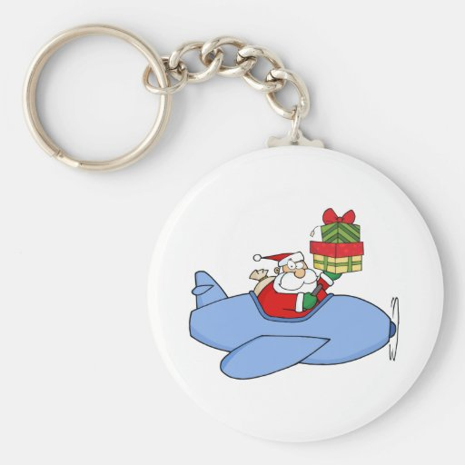 Papá Noel que soporta una pila su avión del navida Llaveros