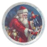 Papá Noel y juguetes Plato