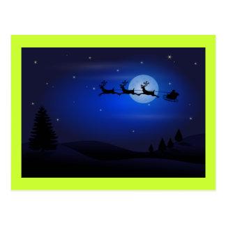 Papá Noel y reno en la noche Postal