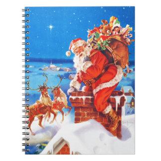 Papá Noel y su reno para arriba en el tejado Cuaderno