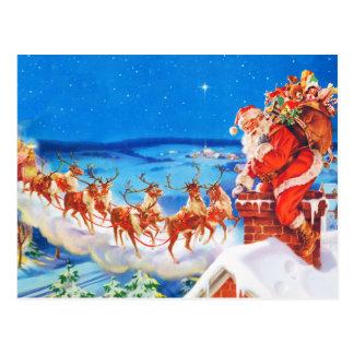 Papá Noel y su reno para arriba en el tejado Postal
