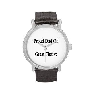 Papá orgulloso de un gran flautista relojes