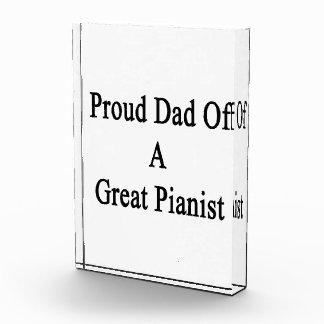 Papá orgulloso de un gran pianista