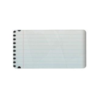 Papel alineado del cuaderno espiral etiqueta de dirección