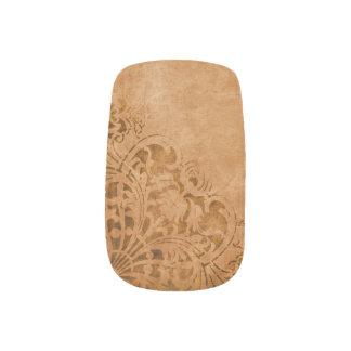Papel antiguo con el modelo gastado pegatina para manicura