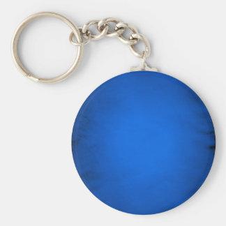 Papel azul arrugado con el proyector llavero redondo tipo pin