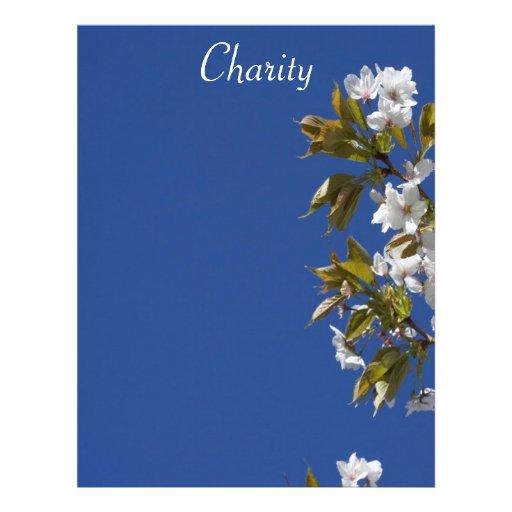 Papel con membrete del flor de la caridad