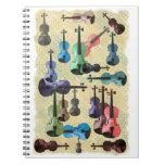 Papel pintado multicolor del violín libro de apuntes con espiral