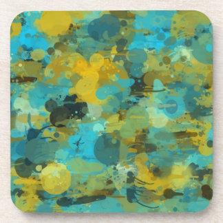 Papel pintado salpicado de la pintura posavasos