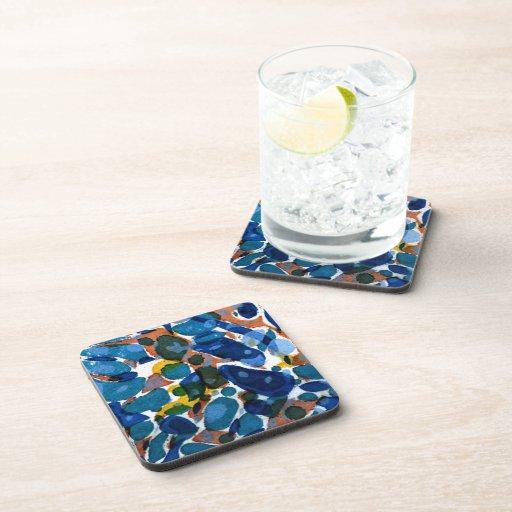 Papel veteado del azul posavasos de bebida