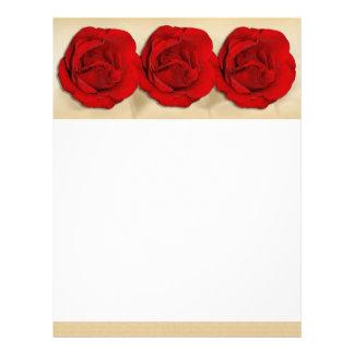 Papeles con membrete elegantes de los rosas rojos