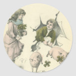 paper girl and boy with pigs round stickers