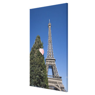 paper heart tied to a tree with the Eiffel tower Canvas Print
