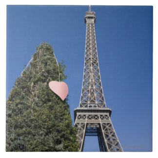 paper heart tied to a tree with the Eiffel tower Ceramic Tile