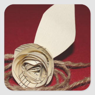 Paper Rose with Twine on Red Background Square Sticker