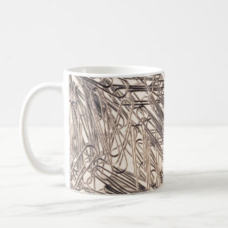 Paperclips for fastening paper sheets together coffee mug