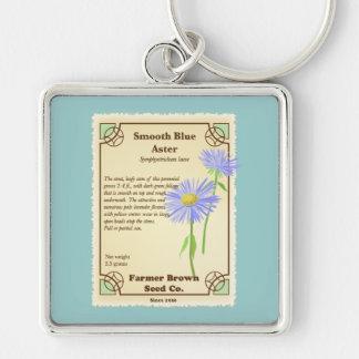 Paquete azul de la semilla del aster llaveros