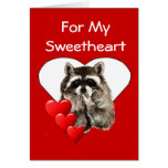 Para mi amor el mapache besa a la tarjeta del día