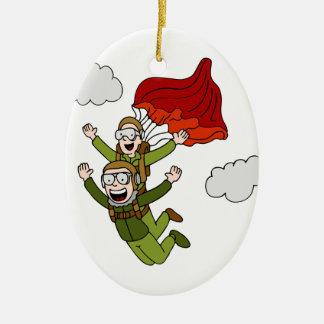 Paracaidismo en tándem adorno navideño ovalado de cerámica