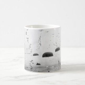 Parachutes open overhead as waves of_War image Coffee Mug