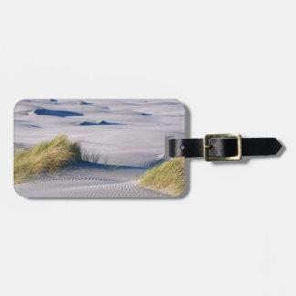 Paradise coastline with wind textured sand dunes luggage tags