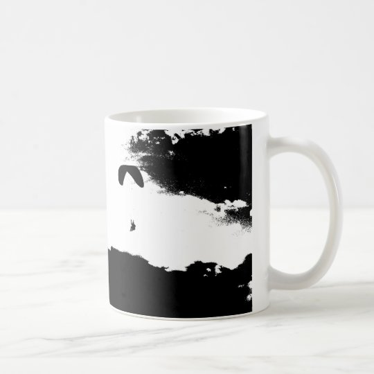 Paragliding above the clouds coffee mug