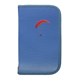 Paragliding in Blue Sky with Red Wing Organizers
