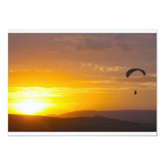 Paragliding on the sunset card