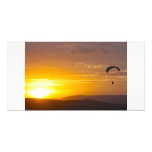 Paragliding on the sunset photo greeting card