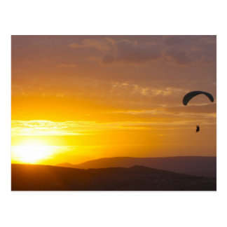 Paragliding on the sunset postcard