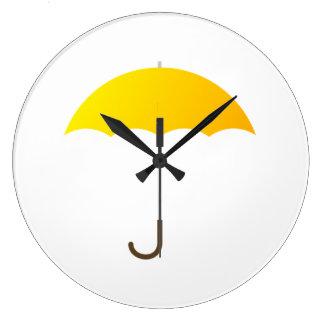 Paraguas amarillo relojes