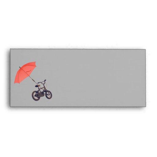 paraguas +bicicleta sobre