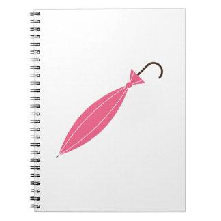 Paraguas cerrado libro de apuntes con espiral