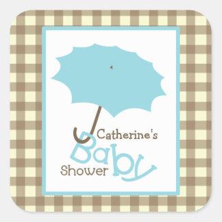 Paraguas de la fiesta de bienvenida al bebé y pegatina cuadrada