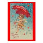 Paraguas de los corazones del Cupid de la tarjeta