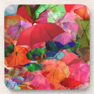 Paraguas multicolores posavaso