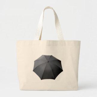 Paraguas negro aislado sobre el fondo blanco bolsa lienzo