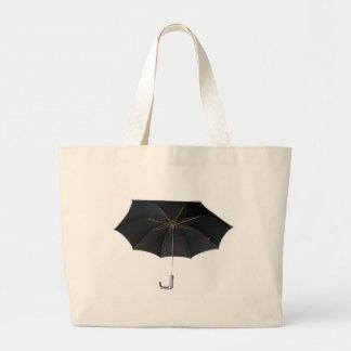 Paraguas negro aislado sobre el fondo blanco bolsa de mano