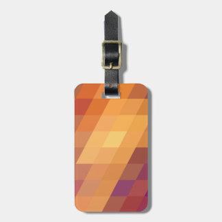 Paralelogramos geométricos del naranja de los etiqueta de equipaje