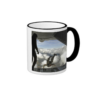 Pararescuemen jump out the back of a C-130 Mug