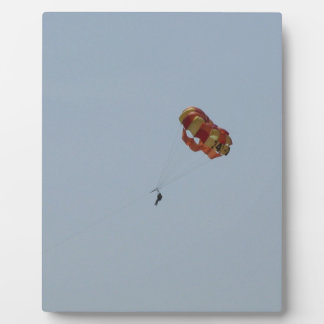Parasailing Above the Ocean Plaque