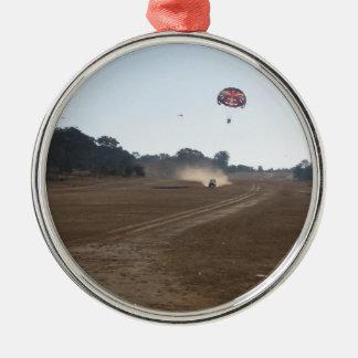 Parasailing behind a vehicle ornament