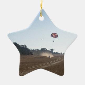 Parasailing behind a vehicle christmas tree ornament