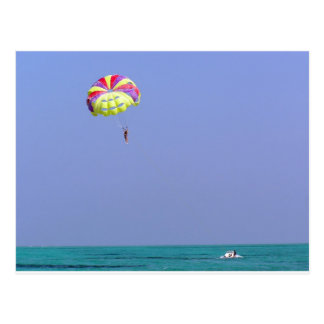 Parasailing over the blue water post cards