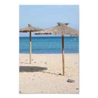 Parasoles de playa de la paja arte con fotos