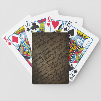 Parchment text with antique writing, old paper bicycle playing cards