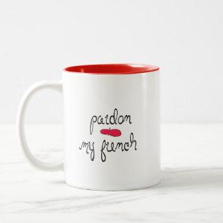 Pardon mi francés con la boina tazas de café