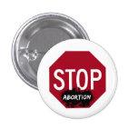 Pare el botón del aborto pins